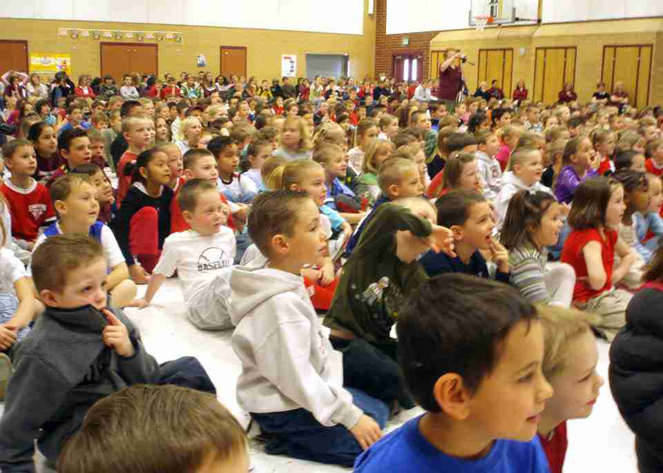 Kids watch as presto performs magic at their school