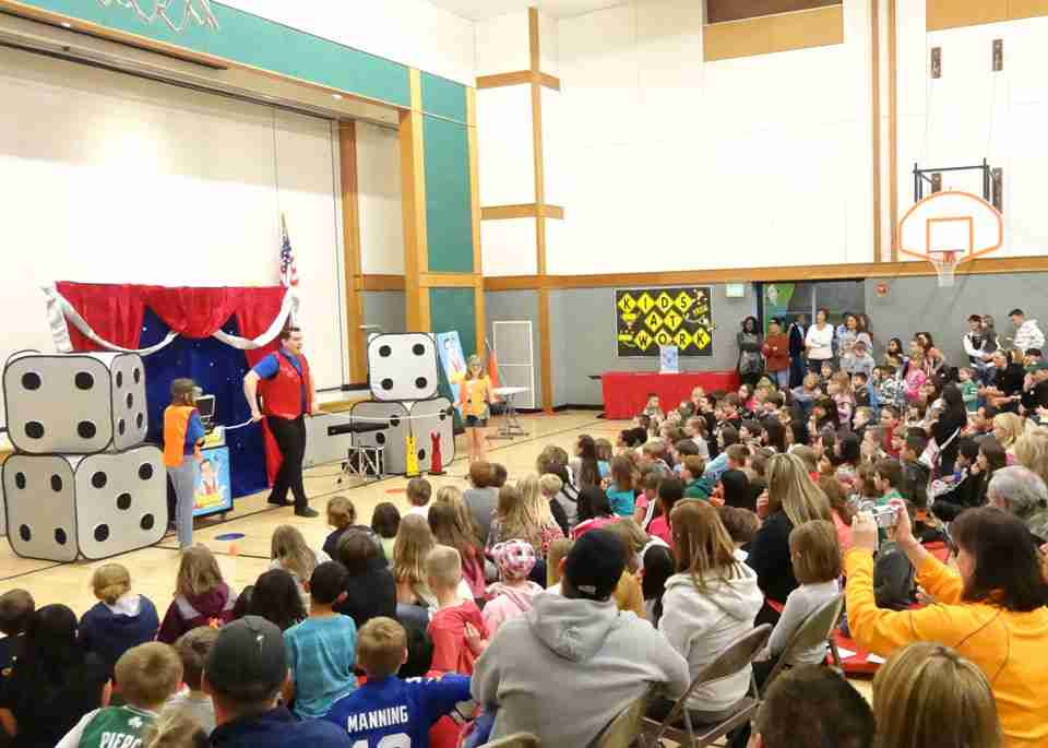 Presto performs his magic show at Oregon Trail Elementary School