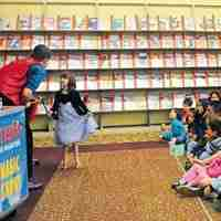 Presto performing at a library summer reading magic show