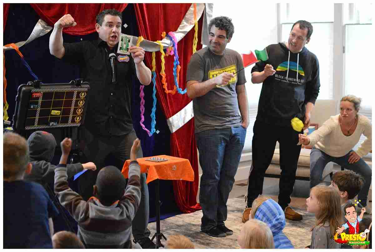Presto entertains a family crowd at a birthday party