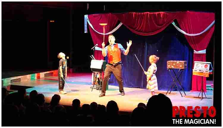 Magic show entertainment on a theater stage