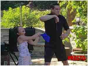 child helps magician at basic birthday party