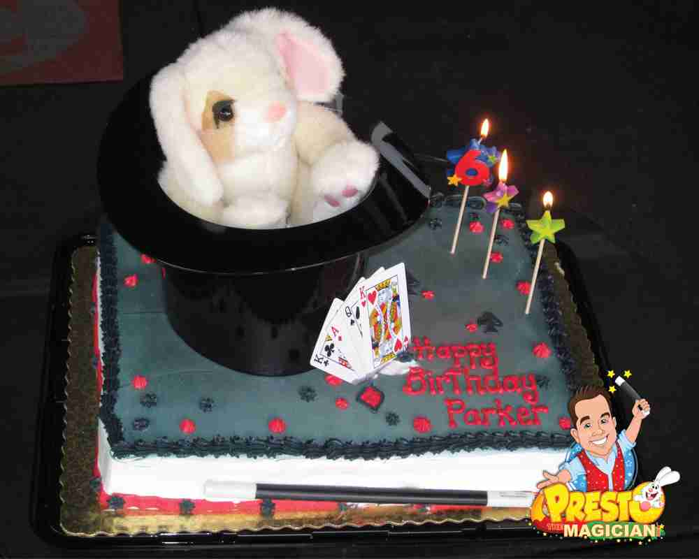 Birthday cake with rabbit, top hat, playing cards, wand