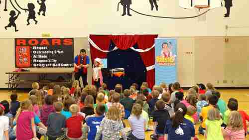 Presto the Magician presenting a reading assembly program